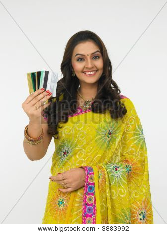 Beautiful Woman Holding A Credit Cards