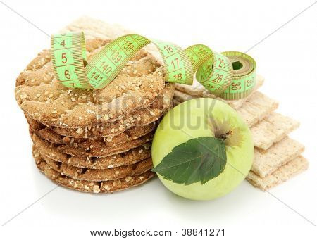 tasty crispbread, apple, measuring tape and ears, isolated on white