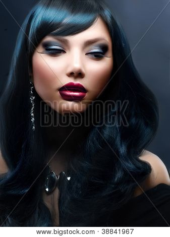 Beauty Brunette Portrait. Beautiful Woman With Black Hair and Holiday Professional Makeup.