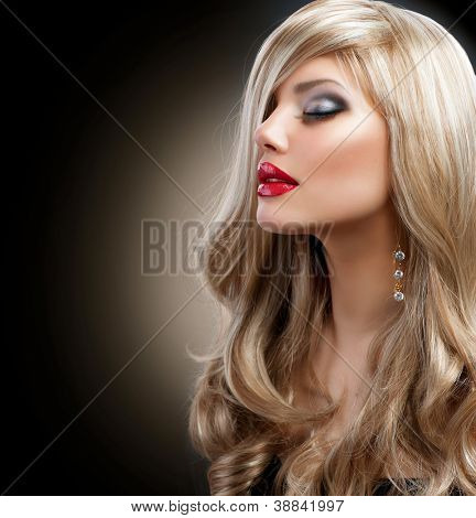 Beautiful Sexy Blond Girl. Long Hair. Blonde isolated on Black Background. Holiday Makeup.Make-up. Glamour Woman