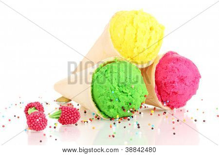 Three scoops of lemon, strawberry and kiwi ice cream in the waffle cones decorated with sprinkles