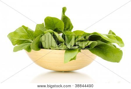Fresh spinach in wooden bowl isolated on white