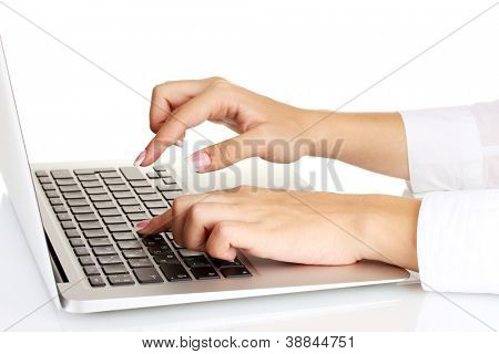 business woman's hands typing on laptop computer, on white background close-up