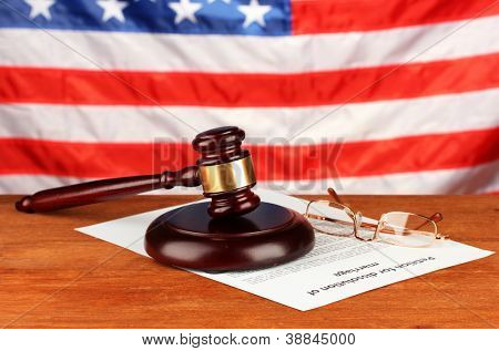 Divorce decree and wooden gavel on american flag background