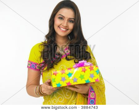 Asian Woman Of Indian Origin With Gift Boxes