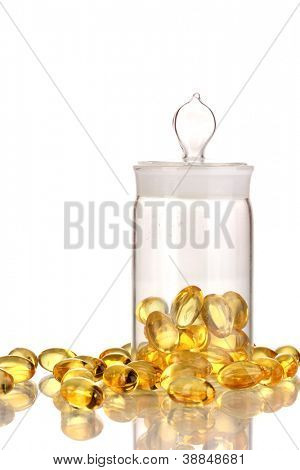 Capsules in receptacle isolated on white
