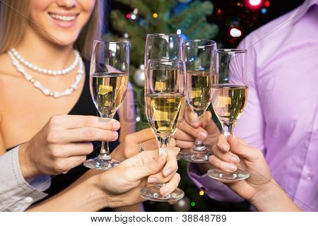 Image of people hands with crystal glasses full of champagne