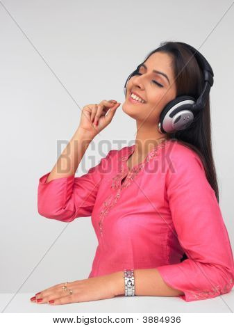 Woman Wearing A Headphone And Listening To Music