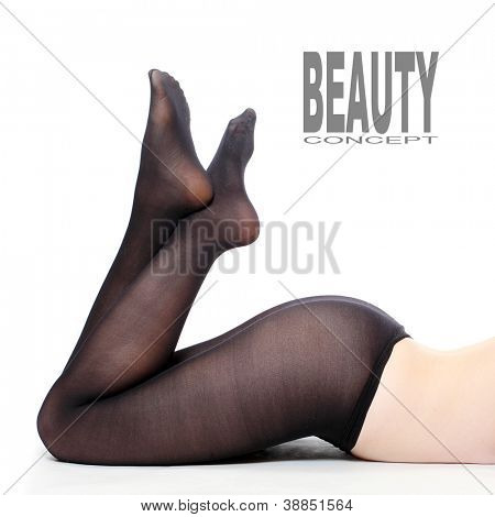 Women's legs in black nylons. Picture with space for your text.