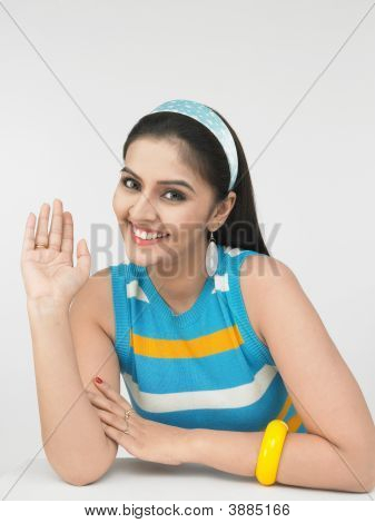 Asian Woman Waving Her Hand