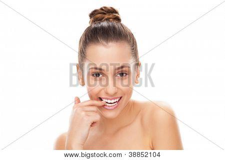 Flirtatious woman biting her nail