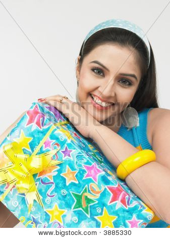 Asian Woman Of Indian Origin With A Gift Box