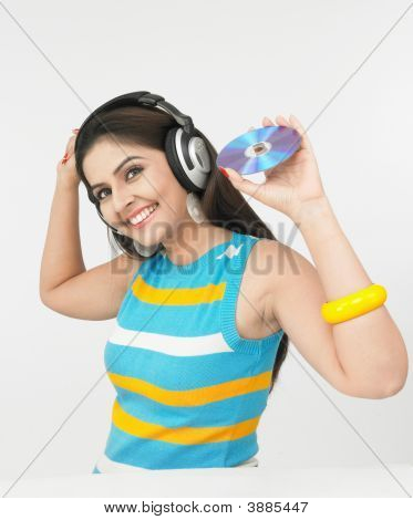 Woman Enjoying Music With Her Headphones On