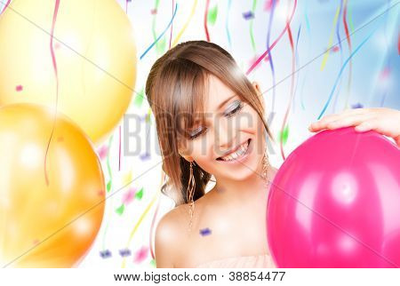 picture of happy teenage girl with balloons