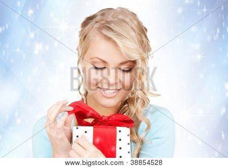 happy woman with gift box over christmas lights