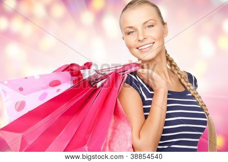 lovely woman with shopping bags over colorful background