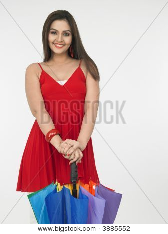 Asian Woman With A Closed Rainbow Umbrella