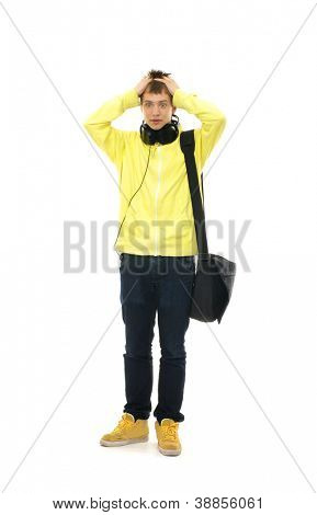 Young smart teenage boy in trouble  isolated on white