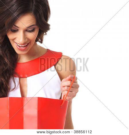 Junge schöne Frau mit einigen Einkaufstüten, isolated on white