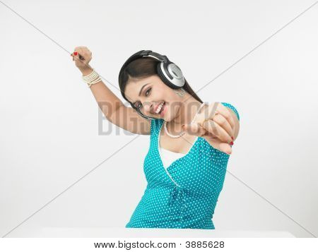 Asian Female Of Indian Origin Enjoying Music