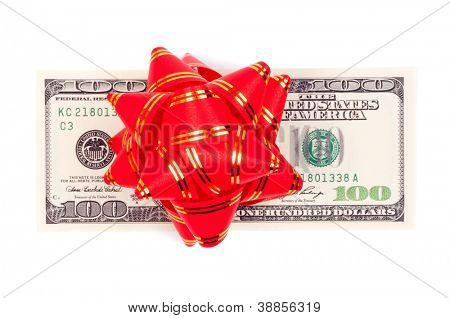 Decorative red bow on the American hundred Dollar-bill, isolated on white