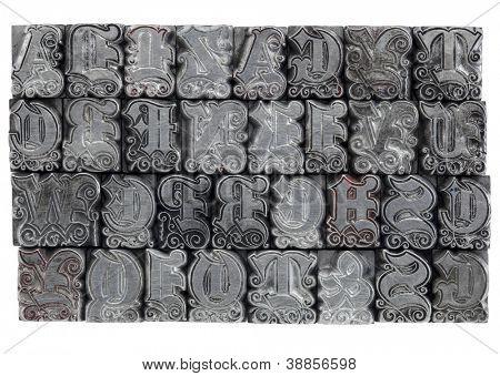 random alphabet letters in decorative metal letterpress type - initials font