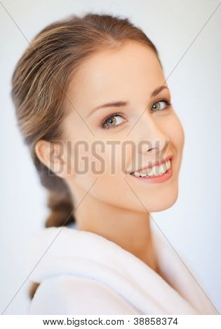 bright closeup portrait picture of beautiful woman in bathrobe