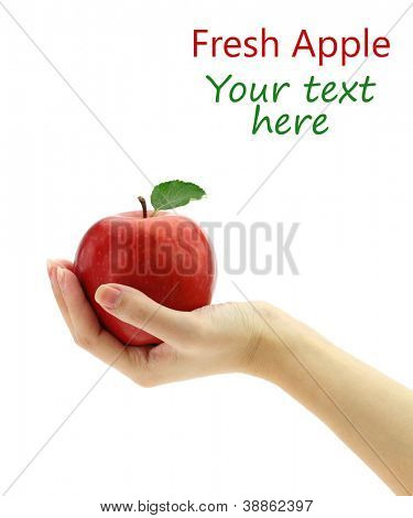 Female hand holding fresh apple