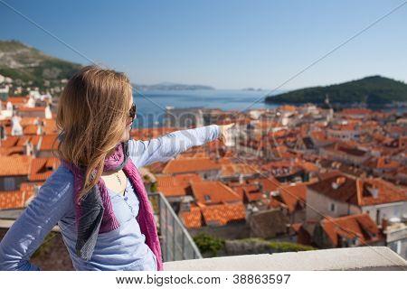 Young woman sightseeng, Dubrovnik, Croatia