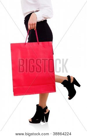 Woman holding a red shooping bag, isolated on white