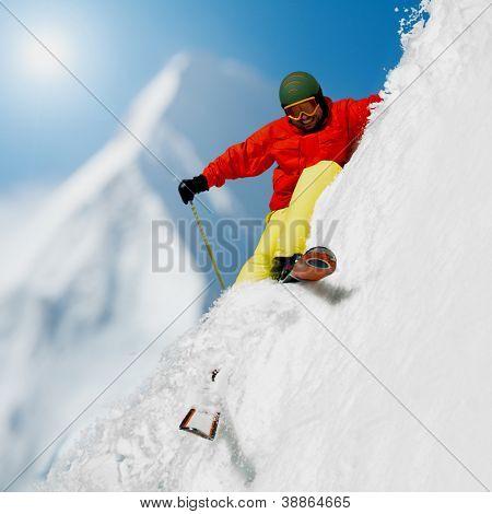 Freeride in fresh powder snow - man skiing downhill