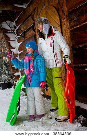 Winter, snow, sledding - family fun at winter time