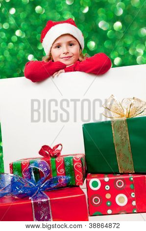Christmas, kid  - Lovely Santa Claus with Christmas gifts and white board - Space for text