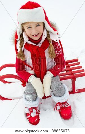 Winter fun, snow, kid sledding at winter time