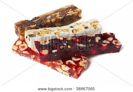 Sweet turkish delights with nuts on white background