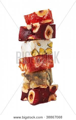 Sweet turkish delights with nuts, isolated on white background