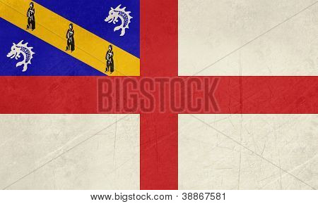 Grunge sovereign state flag of dependent country of Herm in official colors.