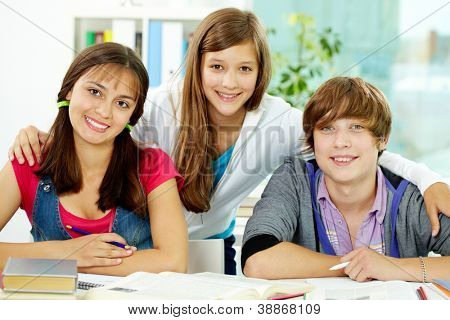 Portrait of smart classmates looking at camera in college