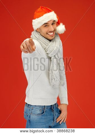 bright picture of handsome man in christmas hat .