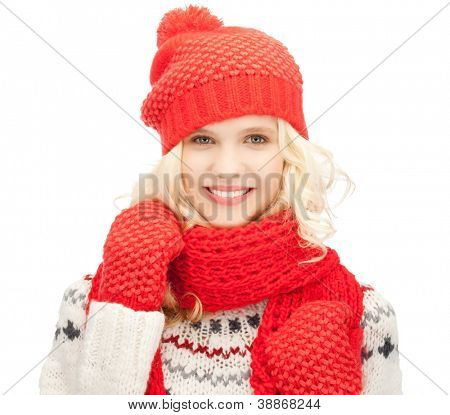 bright picture of beautiful woman in hat, muffler and mittens ..