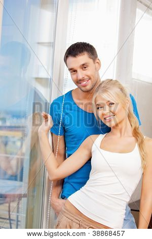 bright picture of happy couple at the window