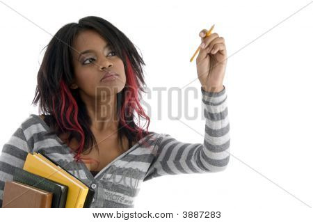 Girl With Books And Looking To Pencil