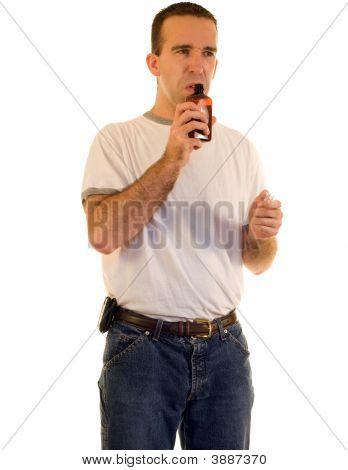 Man Smelling Cough Medicine
