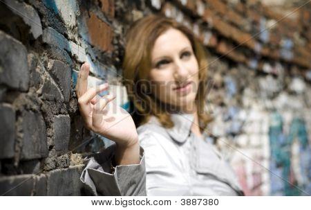 Woman Against A Brick Wall