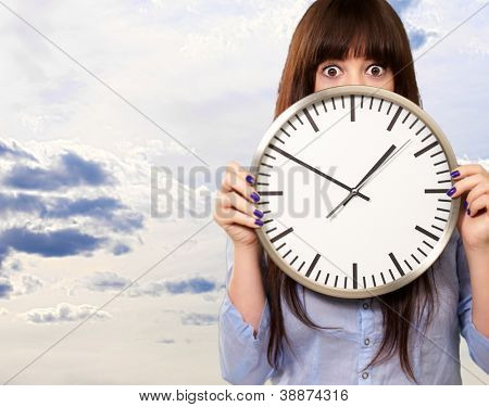 Woman Holding Clock, Outdoor