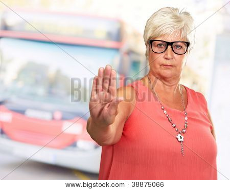 Portrait Of A Senior Woman Showing Stop Sign, Outdoor