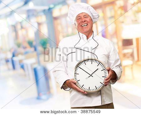 Portrait Of Chef Showing Watch, Outdoor