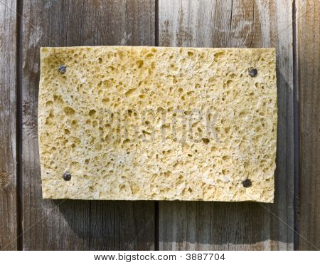 Sponge On Wooden Background