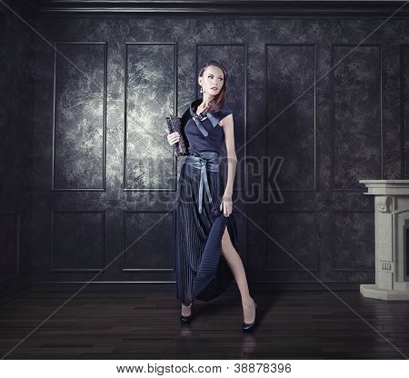 young  beautiful woman posing in an vintage room