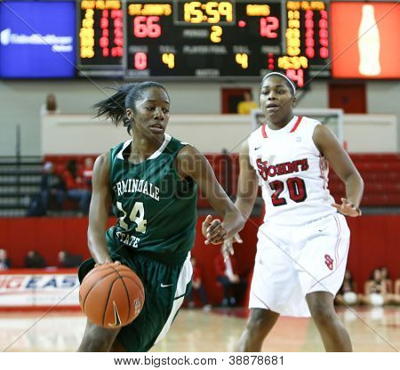 NEW YORK-NOV 3: Farmingdale Rams forward Siohban Purvis (14) dribbles past St. John's Red Storm guard Keylantra Langley (20) at Carnesecca Arena on November 3, 2012 in Jamaica, Queens, New York.